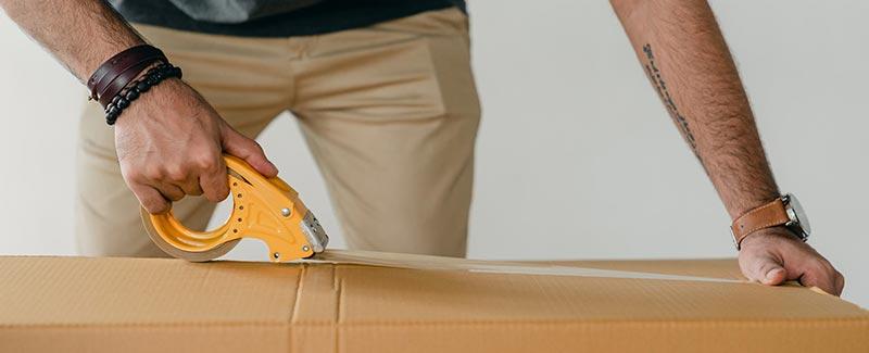 Man storing away box