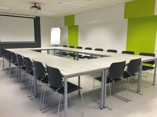 Large square and rounded table in a conference room