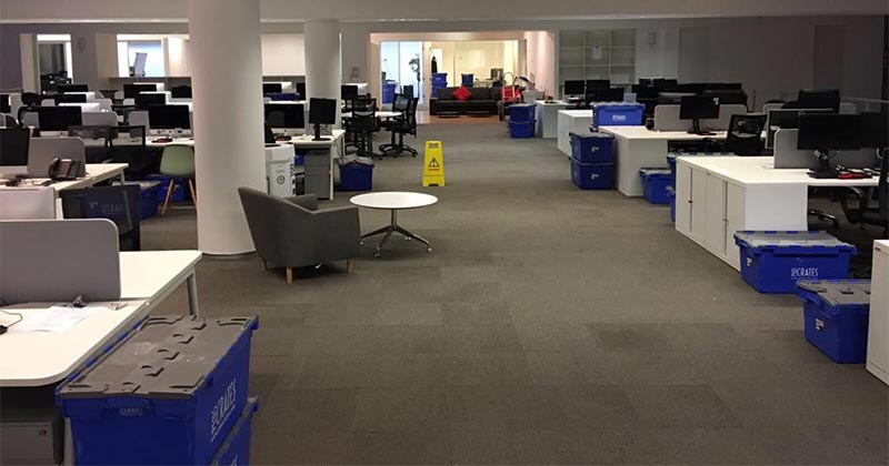 Office in London, blue plastic crate