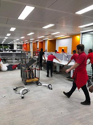 Porters clearing an office